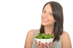 Attractive Happy Healthy Young Woman Holding A Bowl of Fresh Raw Spinach Royalty Free Stock Images