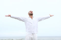 Attractive and happy man on beach Stock Image