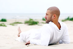 Attractive and happy man on beach Stock Images