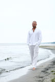 Attractive and happy man on beach Royalty Free Stock Photos