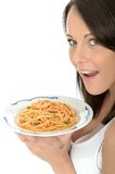 Attractive Happy Natural Young Woman Holding a Plate of Italian Spaghetti Bolognese Stock Photo