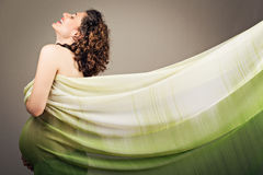 Attractive happy pregnant woman in green Royalty Free Stock Photo