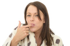 Attractive Happy Relaxed Cosy Young Woman Sucking Her Finger Royalty Free Stock Images