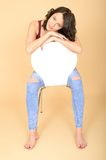 Attractive Happy Relaxed Young Woman Sitting on White Chair Royalty Free Stock Photo