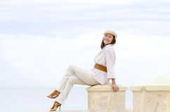Attractive happy retired woman high heels beach Royalty Free Stock Photo