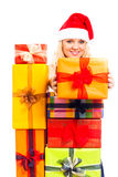 Attractive happy Santa woman with Christmas gift Royalty Free Stock Photos