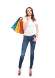 An attractive and happy shopping girl with bags Stock Image