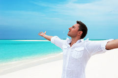Attractive happy smiling man looking up into the distance with h Royalty Free Stock Photography