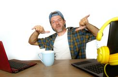 Attractive and happy successful internet blogger man in American royalty free stock photography
