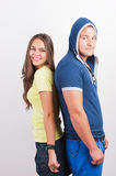 Attractive happy teenage couple Stock Images