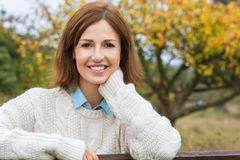 Attractive Happy Middle Aged Woman Resting on Fence stock photos