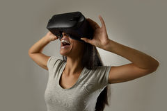 Attractive happy woman excited using 3d goggles watching 360 virtual reality vision enjoying Royalty Free Stock Photos