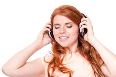 Attractive happy woman with headphones listen to music isolated Stock Photos