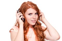 Attractive happy woman with headphones listen to music isolated Royalty Free Stock Photos