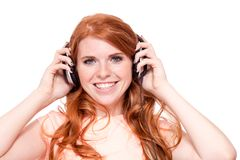 Attractive happy woman with headphones listen to music isolated Stock Photography