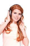 Attractive happy woman with headphones listen to music isolated Royalty Free Stock Photo