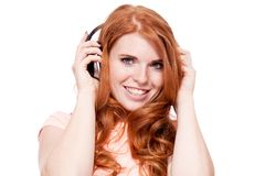 Attractive happy woman with headphones listen to music isolated Royalty Free Stock Images