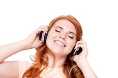 Attractive happy woman with headphones listen to music isolated Stock Image