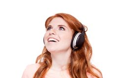 Attractive happy woman with headphones listen Stock Images