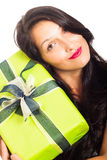 Attractive happy woman holding gift. Close up of young attractive happy woman holding green gift box, isolated on white background Stock Images