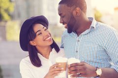 Attractive happy woman looking at her boyfriend. In love. Attractive positive happy women looking at her boyfriend and smiling while having coffee with him Stock Photos