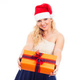 Attractive happy woman Santa with Christmas gift Stock Image
