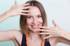 Attractive happy woman showing hands palms. Royalty Free Stock Photos