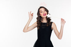 Attractive happy woman using fake crown props and magic stick Stock Photo