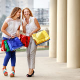 Attractive happy women do shopping Stock Image