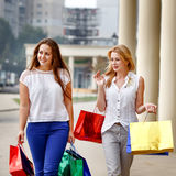 Attractive happy women do shopping Stock Photography