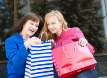 Attractive happy women with shopping bags. Shopping. Stock Photo