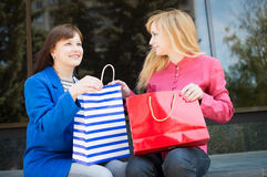 Attractive happy women with shopping bags. Shopping. Stock Image