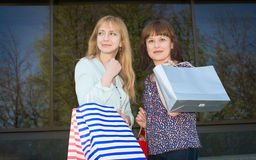 Attractive happy women with shopping bags. Shopping. Royalty Free Stock Photos