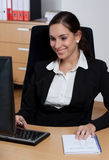 Attractive happy young businesswoman Stock Images