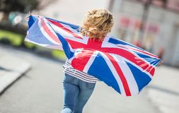 Attractive happy young girl with the flag of the Great Britain. Kingdom brexit united woman english student lifestyle study background england british people stock photo