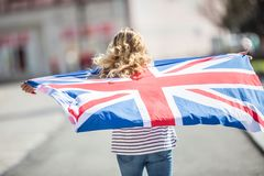 Attractive happy young girl with the flag of the Great Britain. Kingdom brexit united woman english student lifestyle study background england british people royalty free stock photo