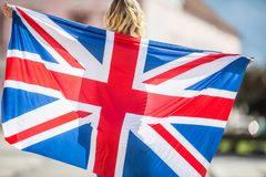 Attractive happy young girl with the flag of the Great Britain. Kingdom brexit united woman english student lifestyle study background england british people royalty free stock image