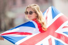 Attractive happy young girl with the flag of the Great Britain. Kingdom brexit united woman english student lifestyle study background england british people royalty free stock images