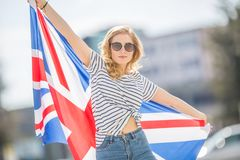 Attractive happy young girl with the flag of the Great Britain. Kingdom brexit united woman english student lifestyle study background england british people royalty free stock photos