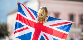 Attractive happy young girl with the flag of the Great Britain. Kingdom brexit united woman english student lifestyle study background england british people stock images