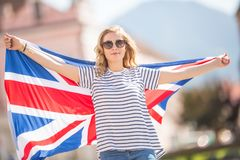 Attractive happy young girl with the flag of the Great Britain. Kingdom brexit united woman english student lifestyle study background england british people stock photos