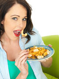 Attractive Happy Young Hispanic Woman Eating a Plate of Seafood Linguine Royalty Free Stock Photos