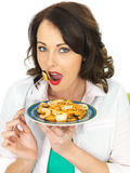 Attractive Happy Young Hispanic Woman Eating a Plate of Seafood Linguine Royalty Free Stock Image