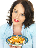 Attractive Happy Young Hispanic Woman Holding a Plate of Seafood Linguine Royalty Free Stock Photo