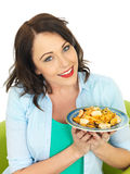 Attractive Happy Young Hispanic Woman Holding a Plate of Seafood Linguine Stock Photo