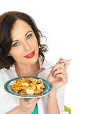 Attractive Happy Young Hispanic Woman Holding a Plate of Seafood Linguine Royalty Free Stock Photography