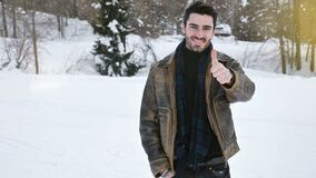 Attractive happy young man smiling, doing thumb up sign. With his hand and then with two hands stock video