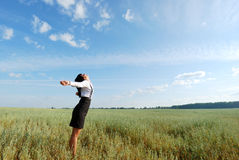Attractive happy young woman in the field. Happy young woman in the wheat field Royalty Free Stock Photos