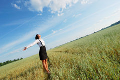 Attractive happy young woman in the field Stock Image