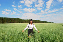 Attractive happy young woman in the field Royalty Free Stock Image